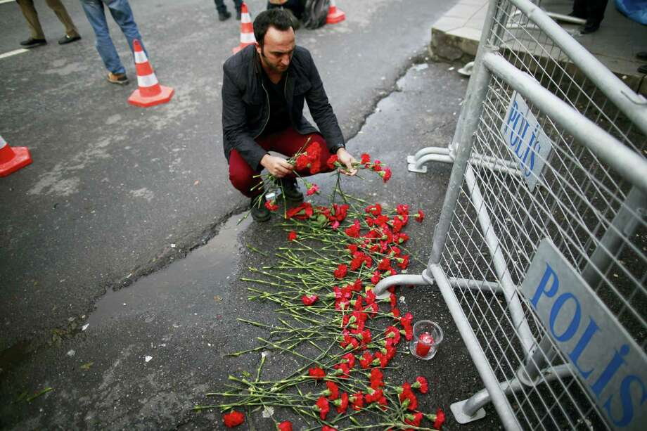 A man leaves flowers for the victims of the attack outside a nightclub which was attacked by a gunman in Istanbul on Sunday. Photo: Emrah Gurel — The Associated Press  / Copyright 2017 The Associated Press. All rights reserved.