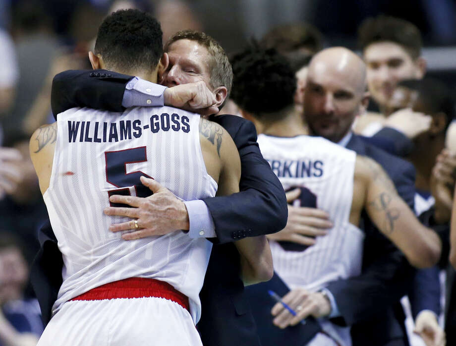 Gonzaga head coach Mark Few hugs guard Nigel Williams-Goss (5) in the closing minutes of a Saturday's win over Xavier. Photo: Tony Avelar — The Associated Press  / FR155217 AP