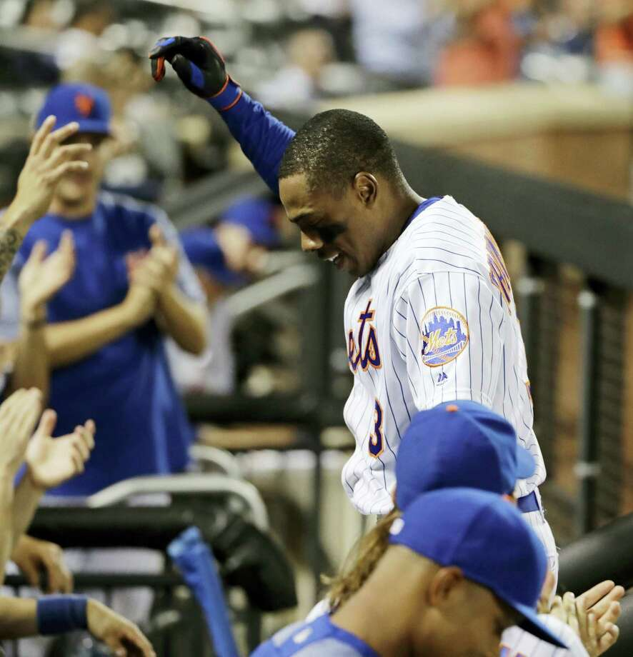 New York Mets' Curtis Granderson gestures to fans during a curtain call after hitting a home run during the eighth inning of the team's game against the Chicago Cubs on Wednesday. Photo: FRANK FRANKLIN II — The Associated Press  / Copyright 2017 The Associated Press. All rights reserved.
