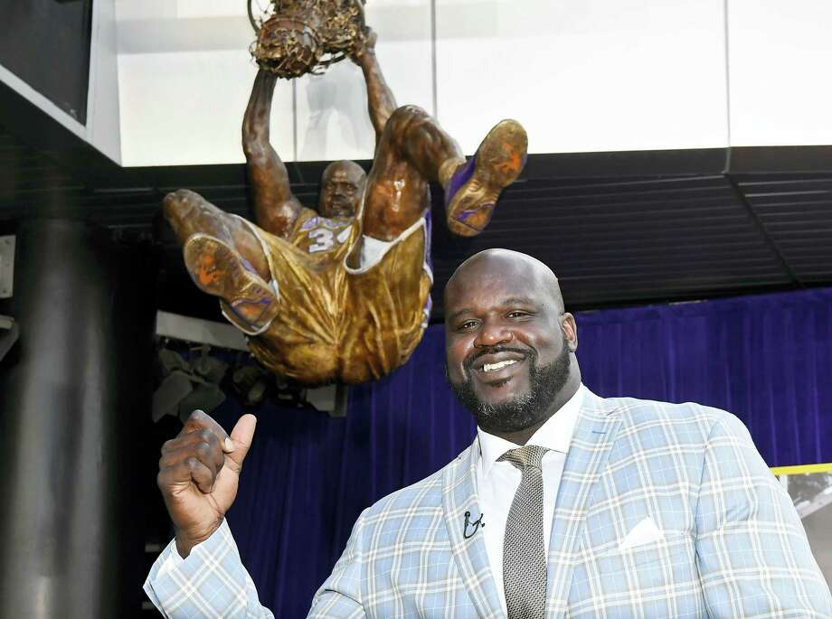 Shaquille O'Neal poses after the unveiling of a statue of him in front of Staples Center on Friday. Photo: Mark J. Terrill — The Associated Press  / Copyright 2017 The Associated Press. All rights reserved.