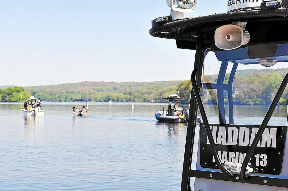 Connecticut State Police, Middletown's South Fire District and Haddam dive teams joined others searching for the 17-year-old Meriden teen who went missing in the Connecticut River at Haddam Meadows Sunday night. Photo: Olivia Drake Photo