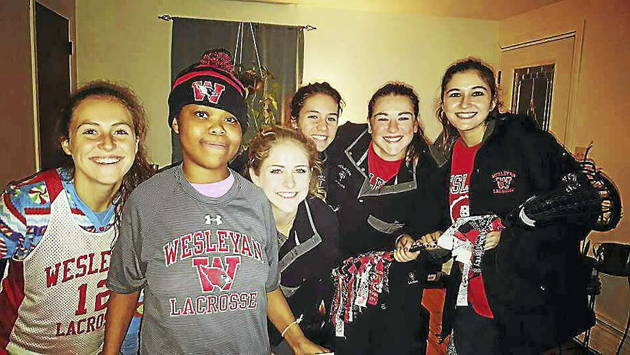 From left are Middletown High School junior Dana Mitchell, sophomore Navaiah Fulk, senior Liana Mathias, sophomore Caroline Sgaglione, senior Grace McCann and junior Elizabeth Spitz, five of the six Team Impact leaders on the team. Sophomore Antonia Kaz, the team leader, is not pictured. In December, the team surprised Navaiah with Wesleyan gear — for her sweet 16 gift. Photo: Contributed Photo