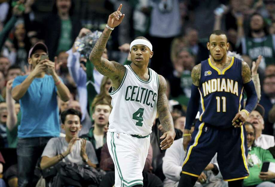 Boston Celtics' Isaiah Thomas (4) reacts beside Indiana Pacers' Monta Ellis (11) after scoring during the fourth quarter of an NBA basketball game in Boston, Wednesday, March 22, 2017. The Celtics won 109-100. (AP Photo/Michael Dwyer) Photo: AP / Copyright 2017 The Associated Press. All rights reserved.
