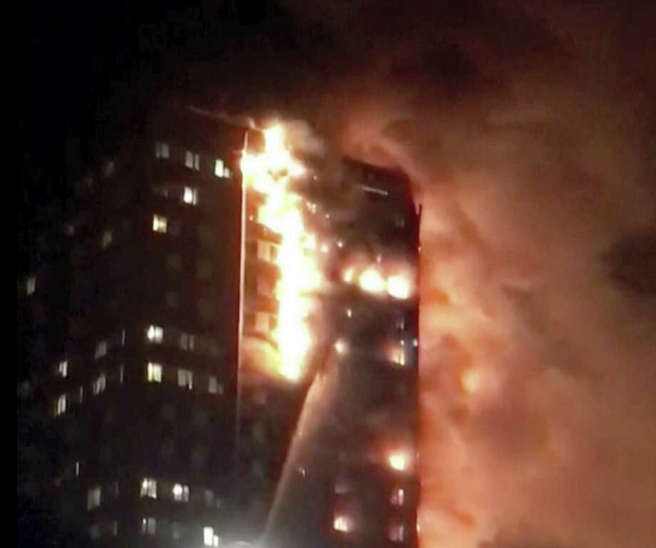 In this image made from video provided by Celeste Thomas @MAMAPIE, a building is on fire in London, Wednesday, June 14, 2017. Firefighters are battling a massive fire in an apartment high-rise in London. One side of the building appeared to be in flames. Photo: Celeste Thomas @MAMAPIE Via AP  / Celeste Thomas @MAMAPIE