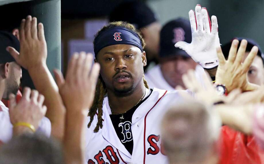 Red Sox designated hitter Hanley Ramirez is congratulated by teammates after his solo home run in the eighth inning on Monday. Photo: Charles Krupa — The Associated Press  / Copyright 2017 The Associated Press. All rights reserved.