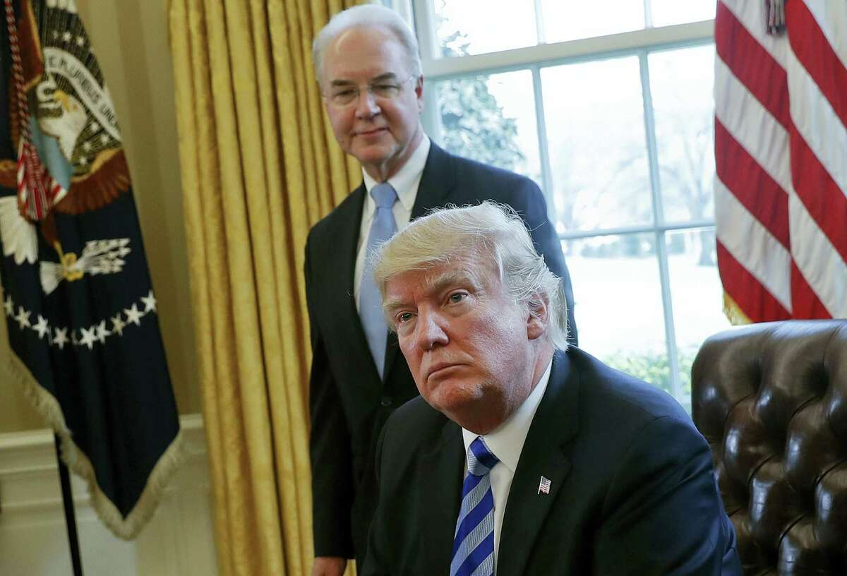 In this March 24, 2017 photo, President Donald Trump with Health and Human Services Secretary Tom Price are seen in the Oval Office of the White House in Washington. For Republicans, health care is becoming a big political gamble. Not only are they trying to scale back major benefit programs being used by millions of people, but they're doing so even as the public is leery of drastic changes, and there's no support outside their own party.