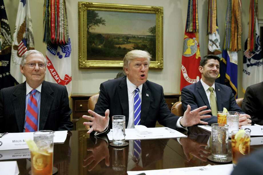 AP Photo — Evan Vucci, File This March 1, 2017 photo shows President Donald Trump, flanked by Senate Majority Leader Mitch McConnell of Ky., left, and House Speaker Paul Ryan of Wis., right as he speaks during a meeting with House and Senate leadership in the Roosevelt Room of the White House in Washington. The president is deploying an outside and inside strategy to fulfill his campaign promise to repeal and replace Obamacare, seeking support beyond Washington before making an in-person pitch on Capitol Hill. Photo: AP / Copyright 2017 The Associated Press. All rights reserved.