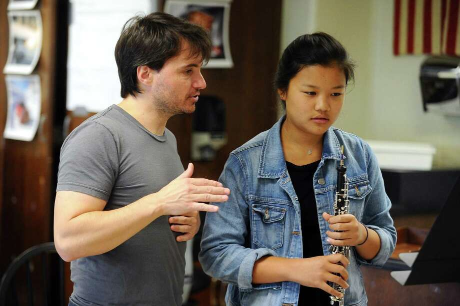 16-year-old oboe player Calla Bai, a junior at Greenwich High School, works with music director Christian Capocaccia during her audition for the Young Artists Philharmonic. Auditions for the Young Artists Philharmonic will be from noon to 4 p.m. Aug. 28 at Temple Sholom, 300 East Putnam Ave. Applicants should expect some sight reading during the audition. Questions regarding the auditions should be directed to Executive Director Greg Robbins at greg@youngartistsphil.org or visit youngartistsphil.org for more on membership requirements. Photo: Michael Cummo / Hearst Connecticut Media / Stamford Advocate