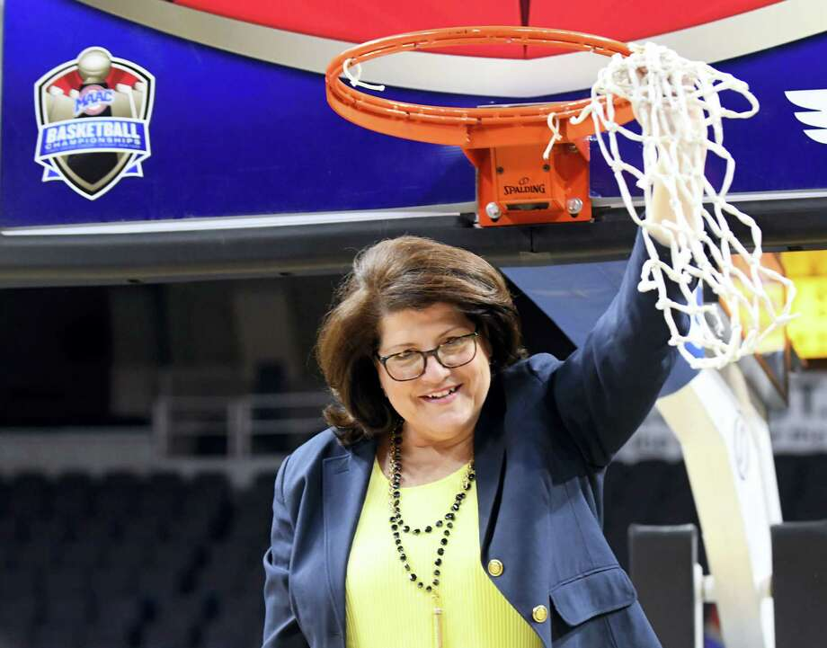 Quinnipiac head coach Tricia Fabbri cuts the net down after a 81-73 win against Rider in the NCAA college basketball championship game in the of the Metro Atlantic Athletic Conference tournament on March 6, 2017 in Albany, N.Y. Quinnipiac won. Photo: AP Photo — Hans Pennink  / Hans Pennink