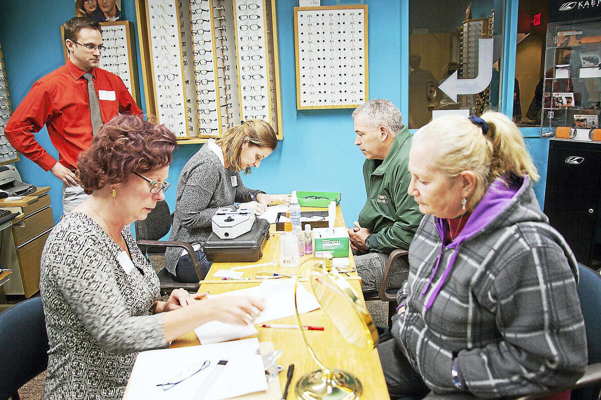 Middlesex Community College in Middletown held its annual Eye Care Day March 6. Shown, from left, are students Esther Nacci, Ron Haas and Maryna Bharara, with their patients.