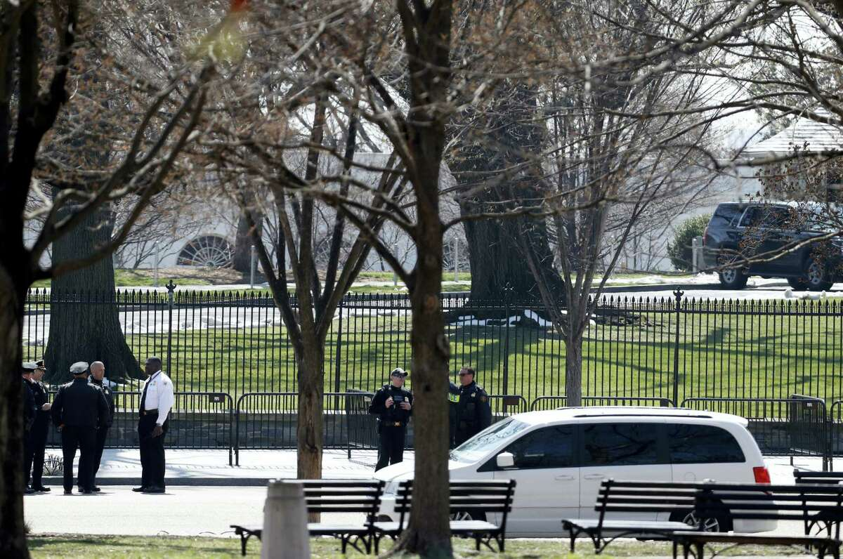 US Secret Service officers stand in the cordoned off area on Pennsylvania Avenue after a security incident near the fence of the White House in Washington, Saturday, March 18, 2017. President Trump was not at the White House at the time of the incident.