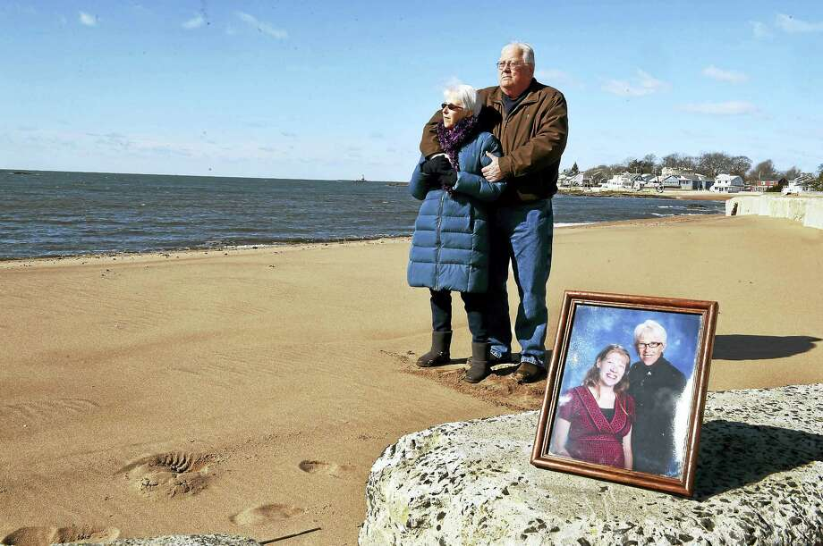 Merry and Douglas Jackson at Silver Sands Beach in East Haven Thursday,  March 16, 2016 with a photograph of their daughter Lori with Merry.  Lori was killed by her estranged husband in May 2014 who broke into her home and shot her. Merry was also in the home at the time and was also shot four times in the attack. Photo: Peter Hvizdak - New Haven Register  / ©2017 Peter Hvizdak