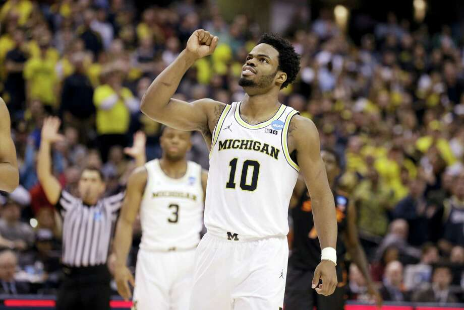 Michigan guard Derrick Walton Jr. (10) celebrates after their win over Oklahoma State on Friday. Photo: The Associated Press  / Copyright 2017 The Associated Press. All rights reserved.