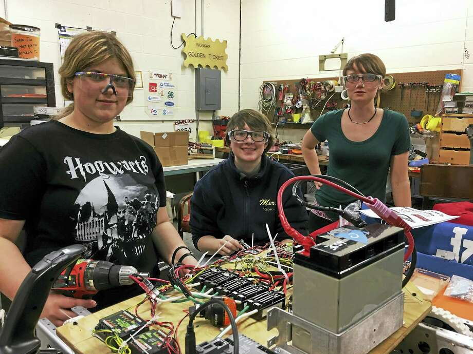 With six years of experience and learning behind them, on their seventh-year Team 3654, the TechTigers of Mercy High School, claimed victory at the New England Waterbury District FIRST Robotic Event on March 5. Here, the TechTigers assemble a robot. Photo: Contributed Photo