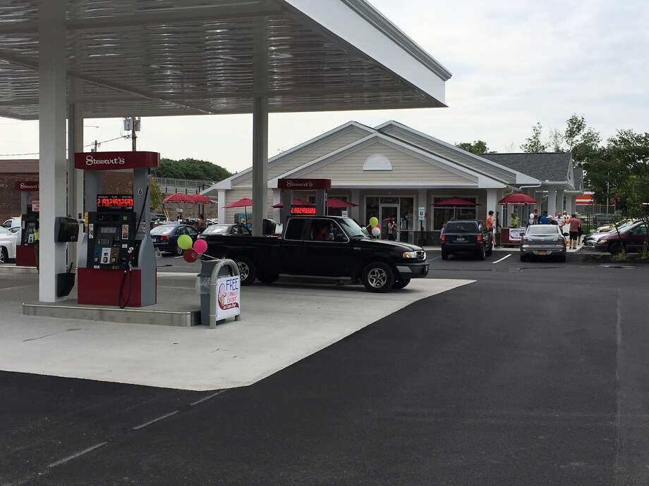 Customers fill their tanks at the newly installed gasoline pumps Friday as Stewart?s Shops teamed up with Pioneer Bank to hold a grand opening celebration at their shared location, 2000 Second Ave., in Watervliet. (Eric Anderson/Times Union)