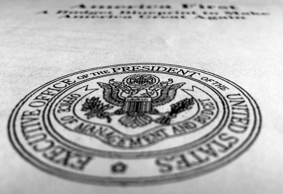 President Donald Trump's first proposed budget, released by the Office of Management and Budget, is photographed in Washington, Wednesday. Military spending would get the biggest boost in President Donald Trump's proposed budget. Environmental programs, medical research, Amtrak and an array of international and cultural programs — from Africa to Appalachia — would take big hits, among the many parts of the government he'd put on a crash diet. Photo: Jon Elswick — The Associated Press  / Copyright 2017 The Associated Press. All rights reserved.