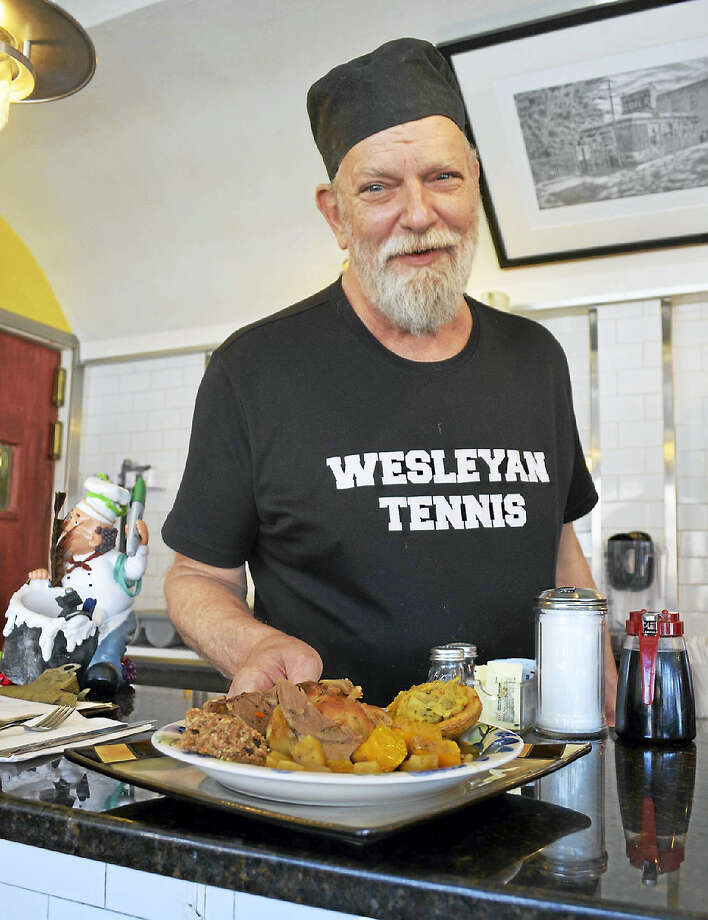 """Brian O'Rourke has run O'Rourke's Diner on Main Street in Middletown since 1976 in a shiny silver 1946 Mountain View diner car in the North End. Staff wear O'Rourke's T-shirts or """"we allow any kind of Wesleyan tee shirt,"""" which he has a huge stash of at home, from nearly every sports team at the university. Photo: Cassandra Day — The Middletown Press"""