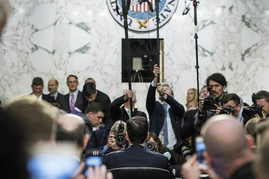 Members of the media photograph James Comey, the former FBI director, before the start of a Senate Intelligence Committee hearing Thursday. Photo: Bloomberg Photo By Zach Gibson  / © 2017 Bloomberg Finance LP
