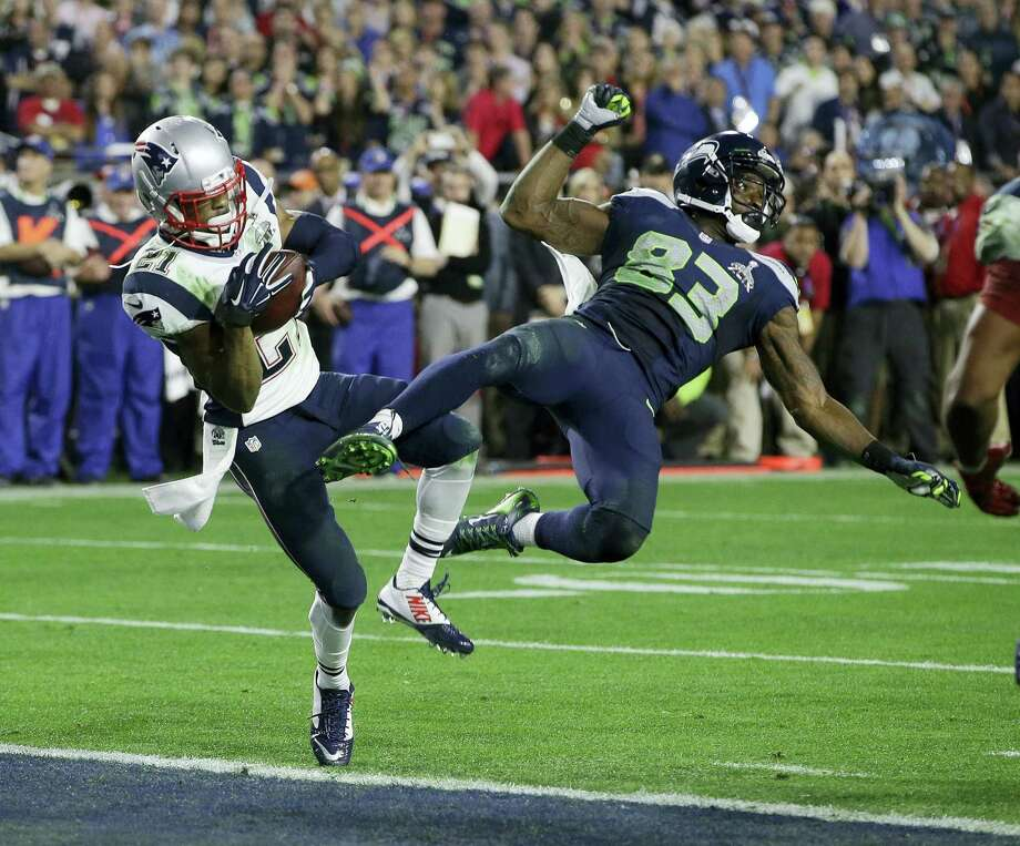 In this file photo, New England Patriots strong safety Malcolm Butler (21) intercepts a pass intended for Seattle Seahawks wide receiver Ricardo Lockette (83) during the second half of NFL Super Bowl XLIX football game in Glendale, Ariz. The Patriots restricted free agent cornerback Malcolm Butler has scheduled a visit with the New Orleans Saints at the team'Äôs headquarters on Thursday according to Saints coach Sean Payton. Photo: Kathy Willens — The Associated Press File  / Copyright 2017 The Associated Press. All rights reserved.