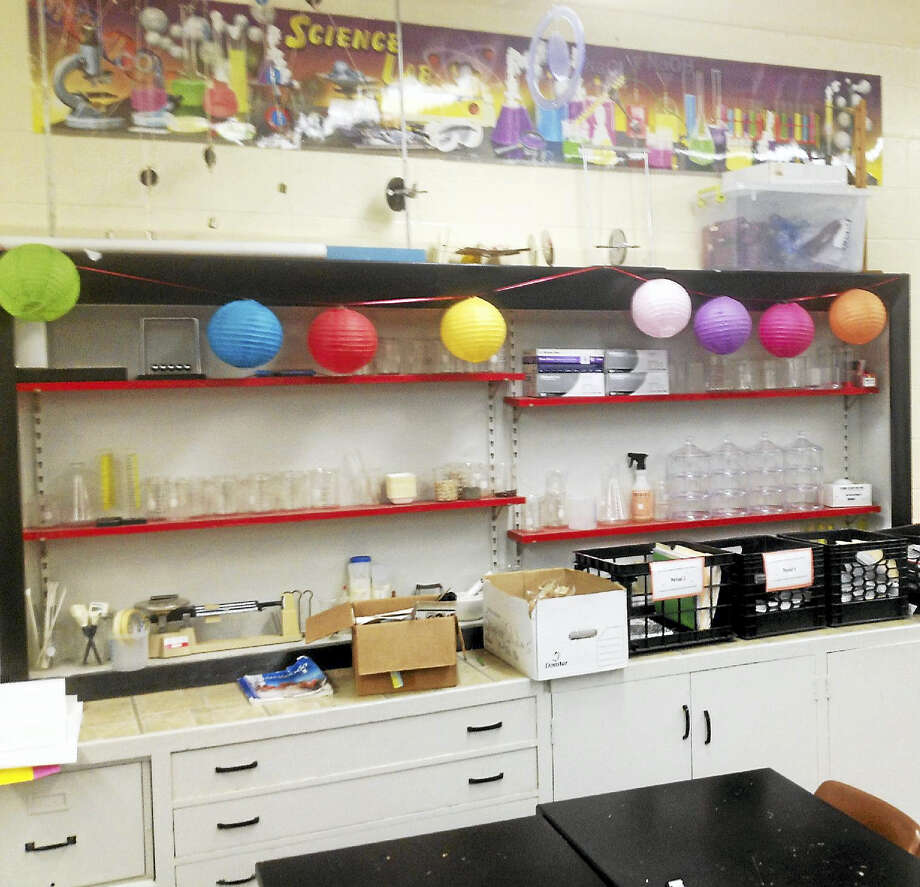 In one classroom at Cromwell Middle School, cabinets are set above a jutting counter, which limits the ability of any number of students to access them, according to the principal. Photo: Jeff Mill — The Middletown Press