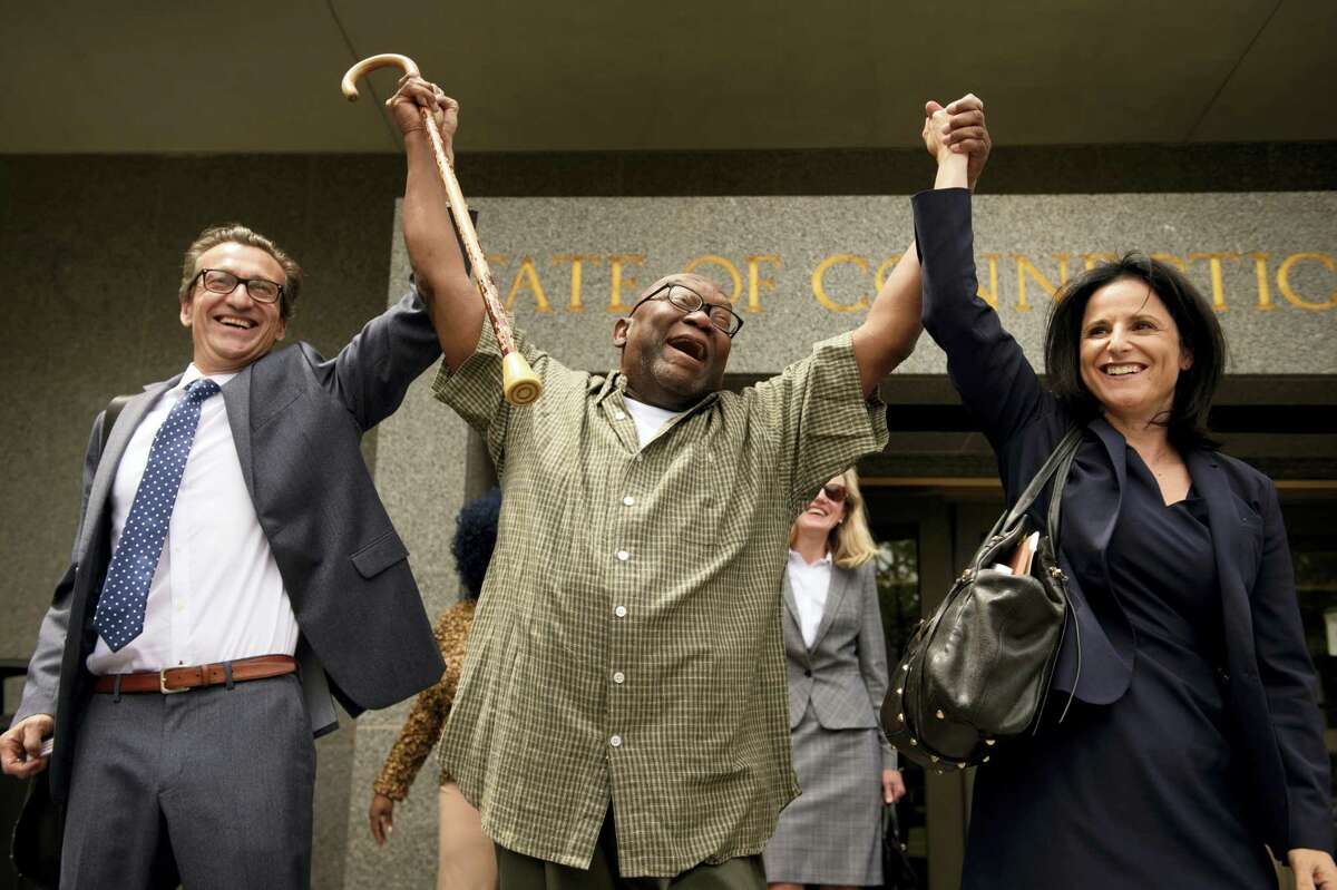 "Shouting ""Freedom,"" Alfred Swinton, middle, walks out of Connecticut Supreme Court Thursday, June 8, 2017, in Hartford, Conn., with Innocence Project lawyers Chris Fabricant, left, and Vanessa Potkin after a Superior Court judge approved a new trial in his conviction in the 1991 murder of Carla Terry. After serving 18 years, Swinton, 68, was released on a promise to appear in court."