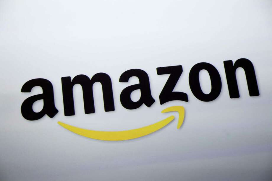 FILE - In this Sept. 28, 2011 file photo, the Amazon.com logo is displayed at a news conference in New York. The e-commerce powerhouse on Tuesday, Sept. 1, 2015 said it will now let members of its $99 annual Prime loyalty program download some shows and movies on its streaming video service to watch offline, or when there is no Internet connection available, for free. Photo: Mark Lennihan — The Associated Press File / AP