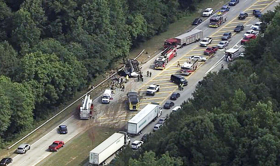 In this image made from video by WSB-TV Atlanta, authorities render assistance to injured people on an overturned church bus, Thursday, June 8, 2017, in Atlanta. Mount Zion Baptist Church in Huntsville, Ala., posted on its Facebook page that one of its buses with its student ministry mission was involved in a crash while traveling to the airport. Photo: WSB-TV Via AP  / WSB-TV
