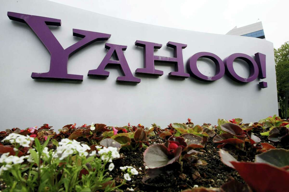 In this April 18, 2011 photo, the Yahoo logo is seen outside of the offices in Santa Clara, Calif. A law enforcement official says the Justice Department is preparing to announce charges against four defendants, including two officers of Russian security services, in a mega data breach at Yahoo.