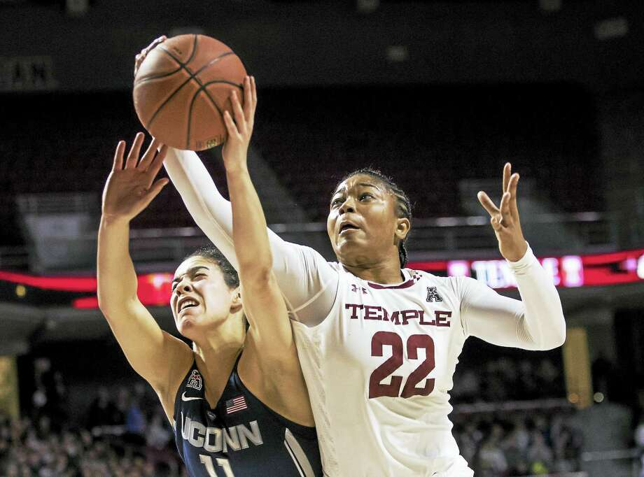 Temple's Tanaya Atkinson, right, reaches for the ball along with Connecticut's Kia Nurse, earlier this year. Photo: Chris Szagola — The Associated Press  / FR170982 AP