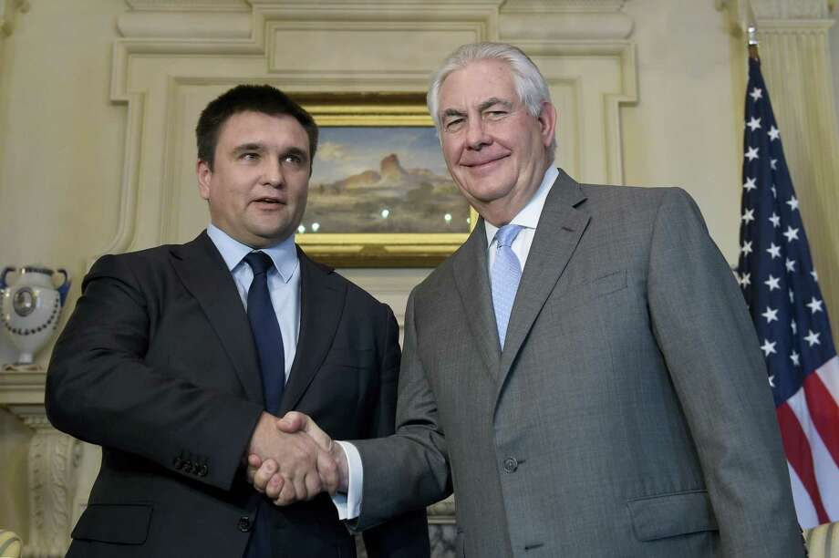 Secretary of State Rex Tillerson (right) shakes hands with Ukrainian Foreign Minister Pavlo Klimkin, at the State Department in Washington on March 7, 2017. Photo: AP Photo — Susan Walsh  / Copyright 2017 The Associated Press. All rights reserved.