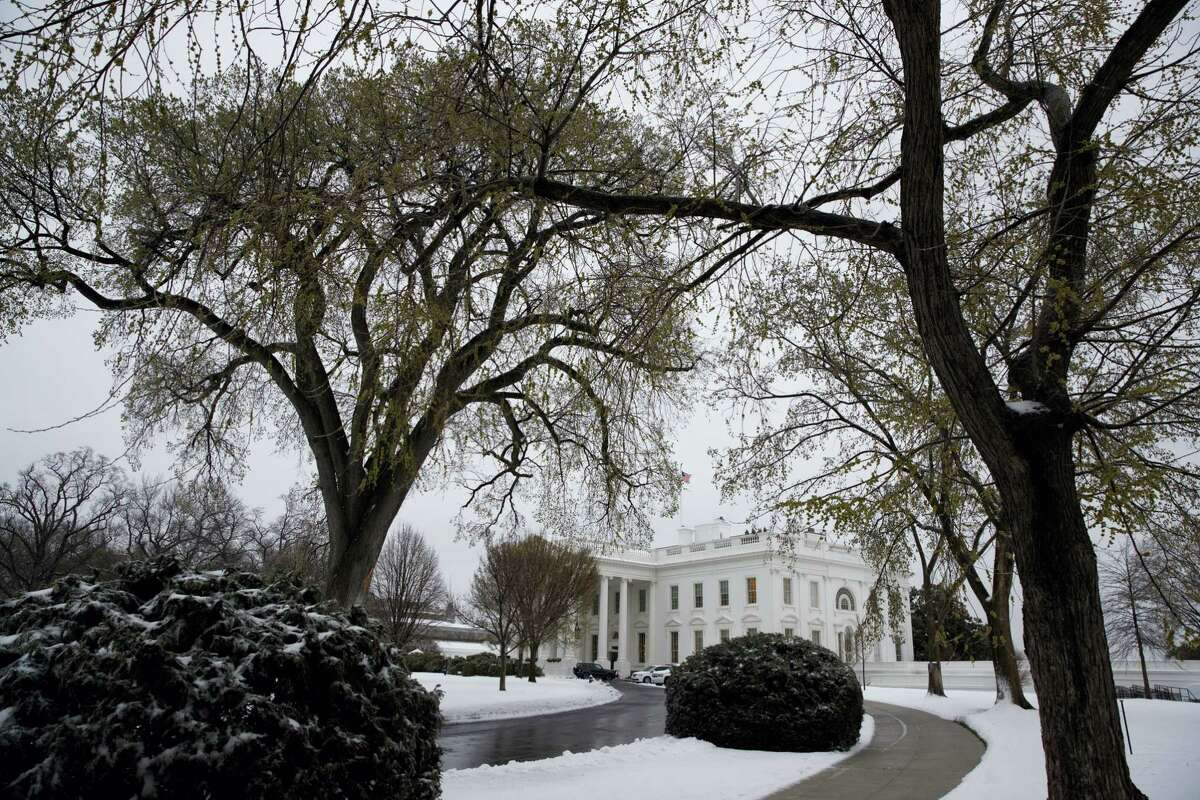 Snow covers the ground outside of the White House in Washington, Tuesday, March 14, 2017. A late-season storm is dumping a messy mix of snow, sleet and rain on the mid-Atlantic, complicating travel, knocking out power and closing schools and government offices around the region.
