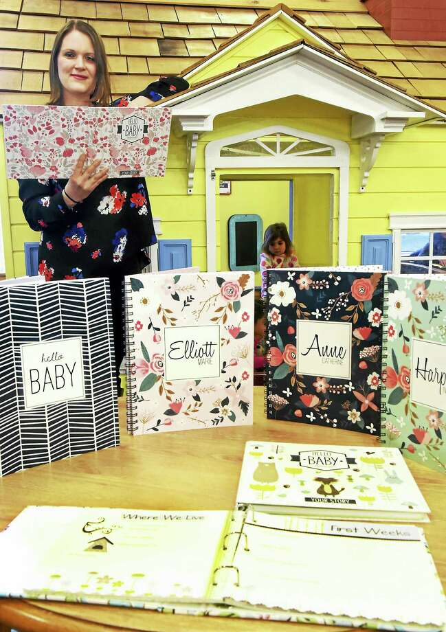 (Peter Hvizdak - New Haven Register) J'aime Ottaviano of Guilford makes crafted baby books for mothers to create and document their babies' early milestones. Photo: ©2017 Peter Hvizdak / ©2017 Peter Hvizdak