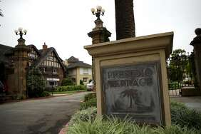 A sign is posted at the entrance to Presidio Terrace on Aug. 9 in San Francisco.