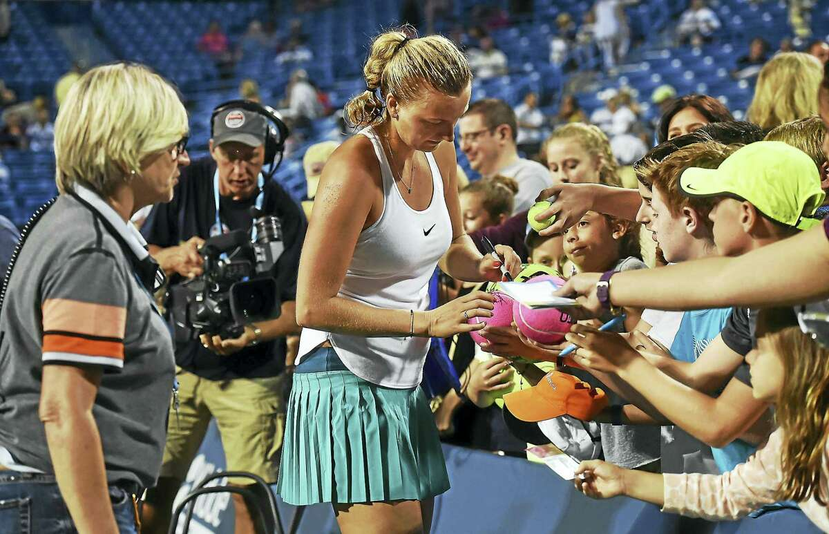 Czech Petra Kvitova signs autographs after defeating Eugenie Bouchardin a 2016 match at the Connecticut Open at the Connecticut Tennis Center at Yale in New Haven.