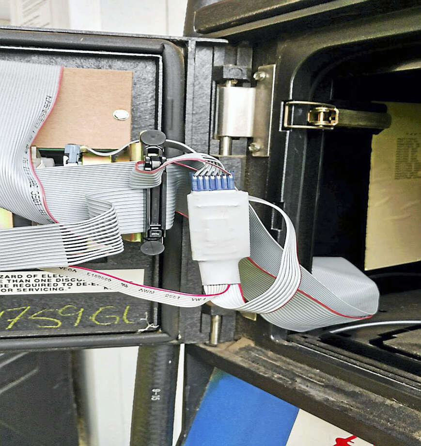 The inside of the gas pump payment system where the card skimming device was found on Tuesday in Essex Photo: Connecticut State Police