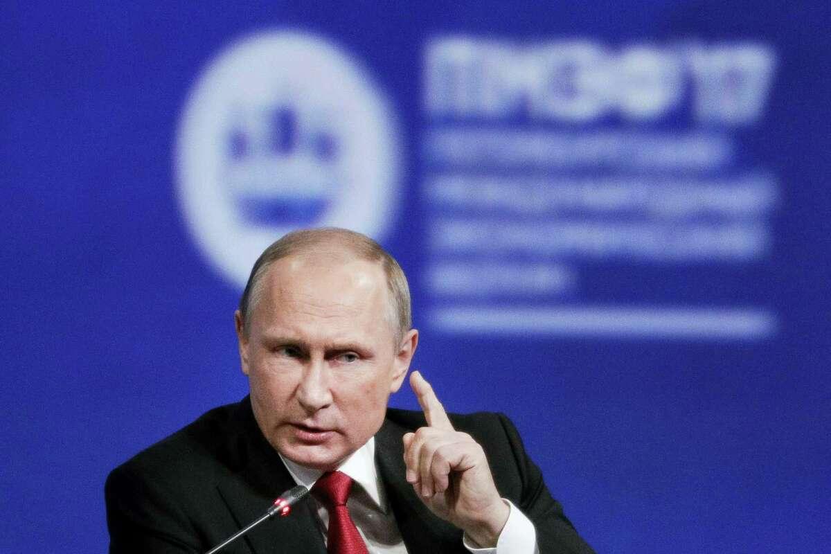 In this June 2, 2017 photo, Russian President Vladimir Putin gestures as he speaks at the St. Petersburg International Economic Forum in St. Petersburg, Russia.