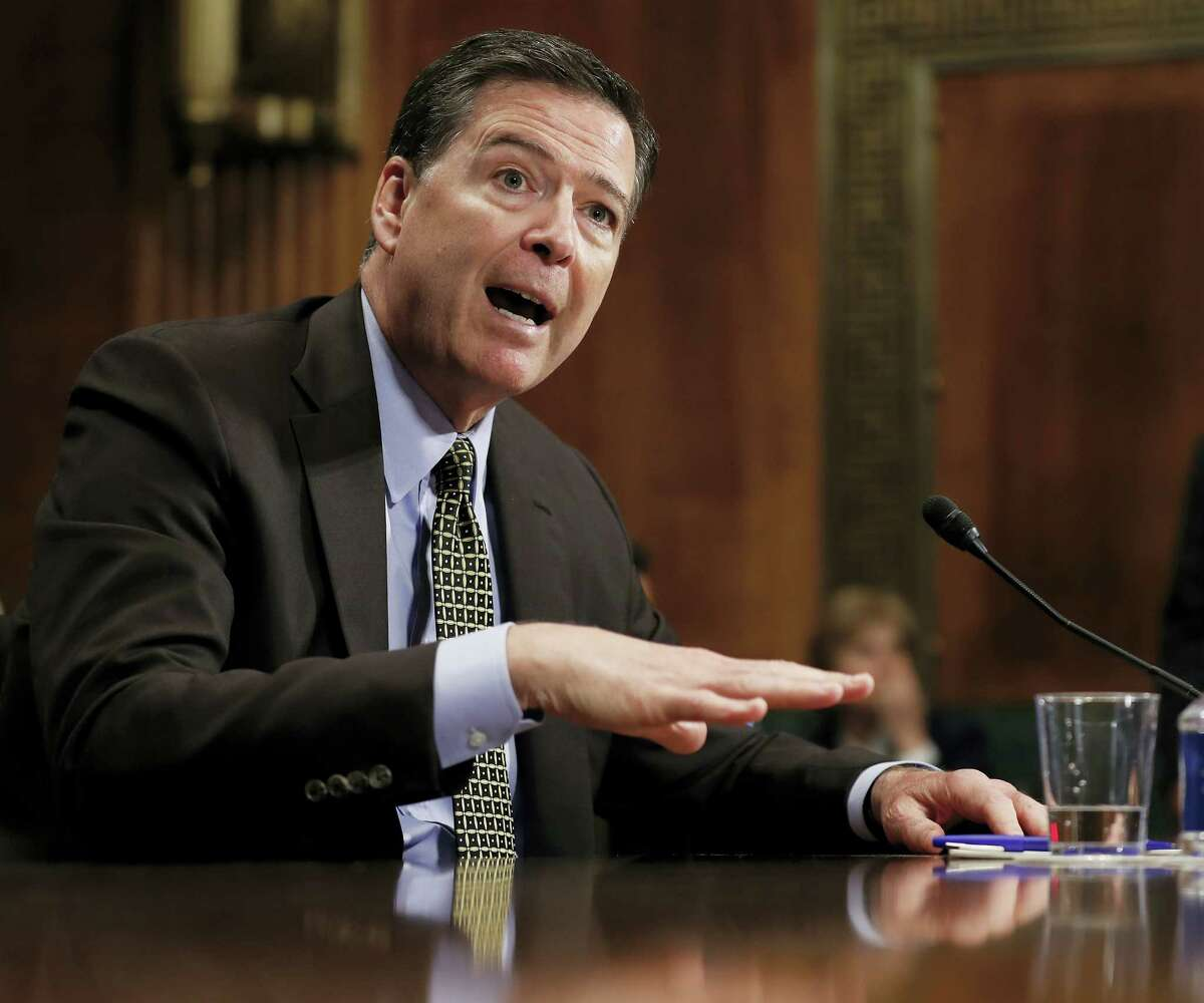 FILE - In this May 3, 2017 file photo, then-FBI Director James Comey testifies on Capitol Hill in Washington. Comey, ousted last month amid a federal investigation into connections between Russia and the Trump campaign, is set to testify before Congress next week in a highly anticipated hearing that could shed new light on his private conversations with the president in the weeks before the firing. (AP Photo/Carolyn Kaster, File)