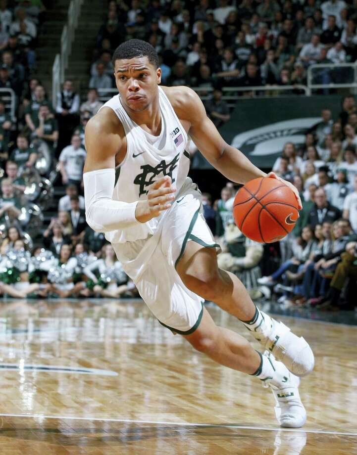 In this Feb. 26, 2017 photo, Michigan State's Miles Bridges drives during the second half of an NCAA college basketball game against Wisconsin, in East Lansing, Mich. Bridges was selected as newcomer of the year for the Big Ten Conference on March 7, 2017. Photo: AP Photo — Al Goldis, File  / FR11125 AP