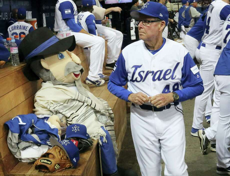 Israel's third base coach Pat Doyle, right, passes by his team mascot, The Mensch on the Bench, during a first-round game of the World Baseball Classic in Seoul, South Korea. Photo: Ahn Young-joon — The Associated Press  / Copyright 2017 The Associated Press. All rights reserved.