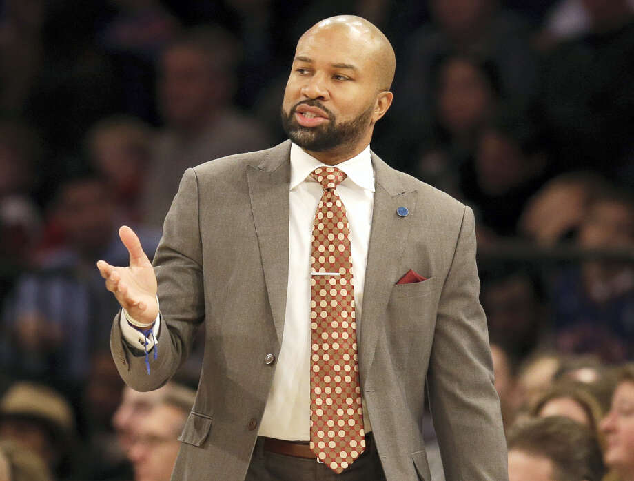 Former New York Knicks head coach Derek Fisher looks on during the first half of the NBA basketball game Feb. 7, 2016 in New York. Photo: AP Photo — Seth Wenig  / AP