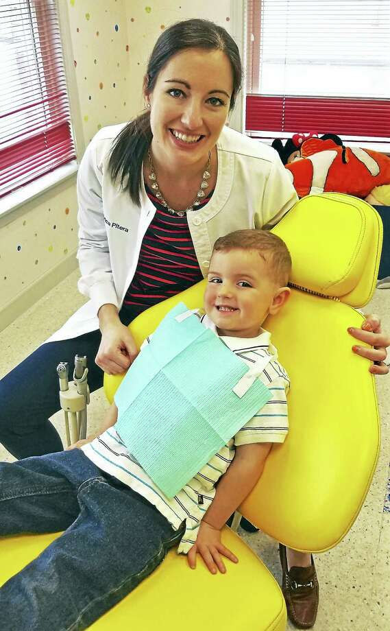Pediatric dentist Erica Pitera with Jacob Pavia, of Middletown. Photo: Photo Courtesy Sweet Tooth Pediatric Dentistry
