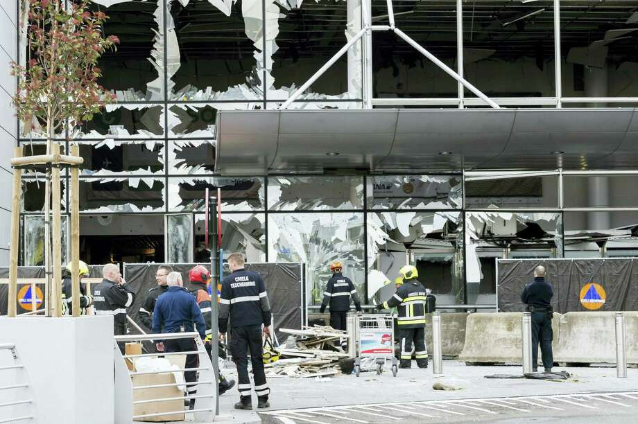 In this March 23, 2016 photo, police and other emergency workers stand in front of the damaged Zaventem Airport terminal in Brussels. The deadly vehicle and knife attack June 3, 2017 on London Bridge and in nearby Borough Market is the latest attack in Europe in recent years. On March 22, 2016, suicide attacks on the Brussels airport and subway kill 32 and injure hundreds. The perpetrators have been closely linked to the group that carried out earlier attacks in Paris. Photo: AP Photo — Geert Vanden Wijngaert, Pool, File  / Copyright 2017 The Associated Press. All rights reserved.