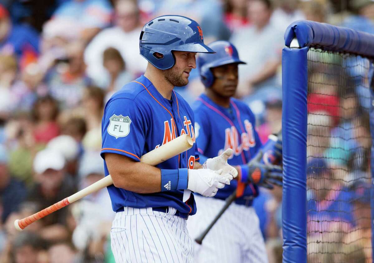 New York Mets designated hitter Tim Tebow walks back to the dugout during a spring training baseball game against the Boston Red Sox in the sixth inning on Wednesday at First Data Field in Port St. Lucie. The Mets won 8-7.