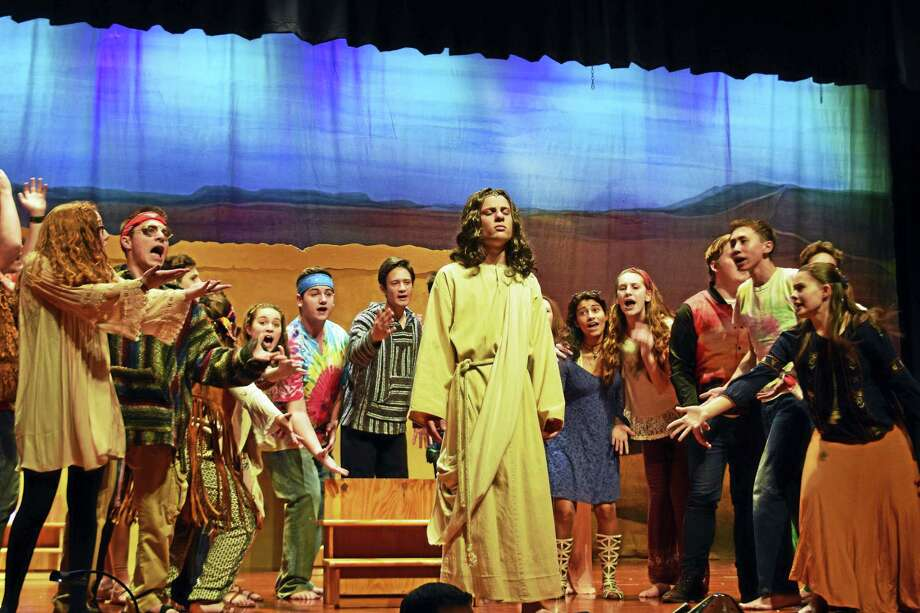 "Jesus, played by Nathaniel Goff, and the ensemble in ""What's the Buzz"" in a scene from ""Jesus Christ Superstar"" presented by the Mercy Xavier Drama Club this weekend. Photo: Contributed Photos"