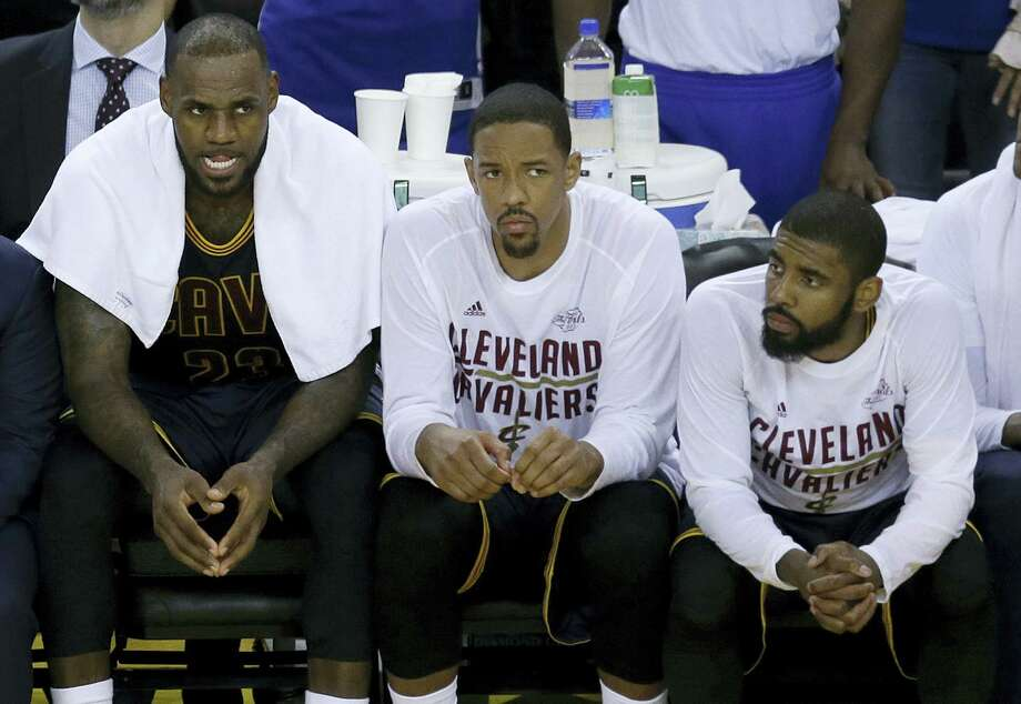 Cleveland Cavaliers forward LeBron James, from left, sits on the bench with center Tristan Thompson and guard Kyrie Irving during the second half of Game 1 of the NBA Finals against the Golden State Warriors in Oakland Thursday. Photo: Ben Margot — The Associated Press  / Copyright 2017 The Associated Press. All rights reserved.