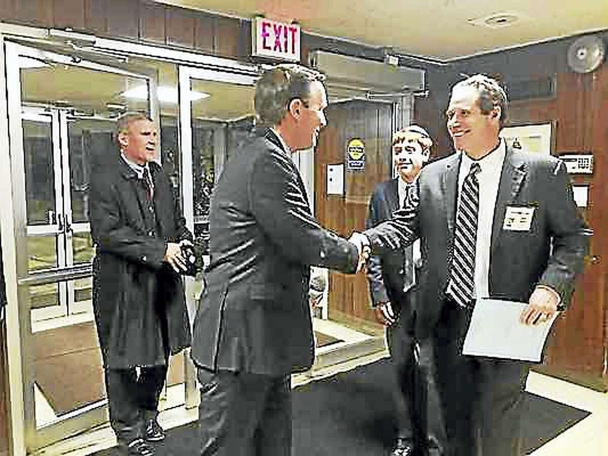 U.S. Sen. Chris Murphy is greeted at Congregation Mishkan Israel recently by his friend, Mishkan Israel board member Joel Rudikoff.
