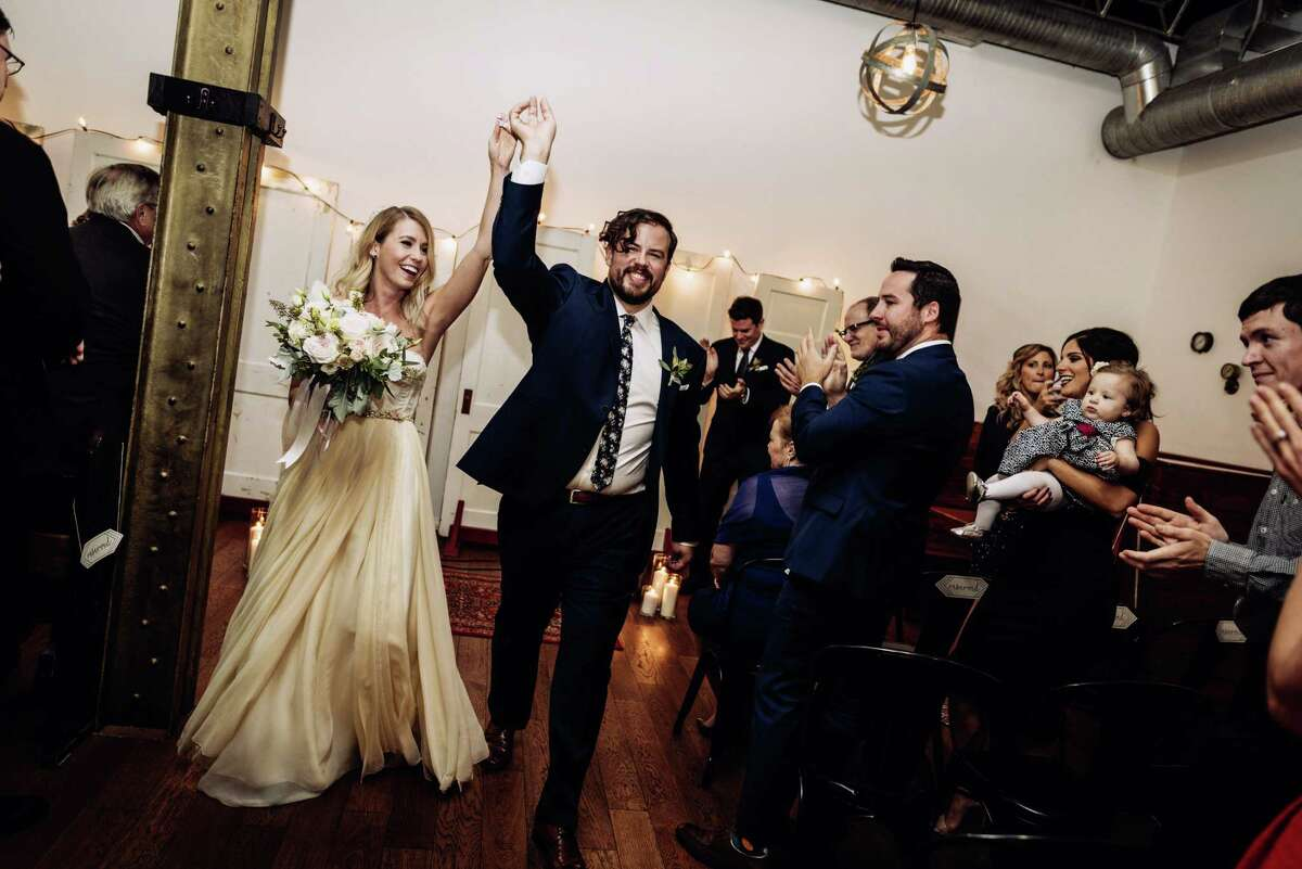 This Oct. 8, 2016 photo provided by Chondon Photography shows newly-married couple Heidi and Rob Cundari after their wedding, in Thunder Bay, Ontario, Canada. Selling your wedding dress used to be a social no-no. Heidi Cundari says she opted for a used dress to keep costs down.