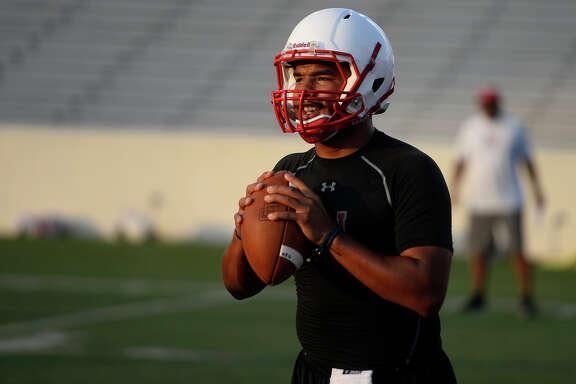 Lamar quarterback Andrew Allen looks to throw during a drill in practice on Monday evening.  Photo taken Monday 8/8/16 Ryan Pelham/The Enterprise