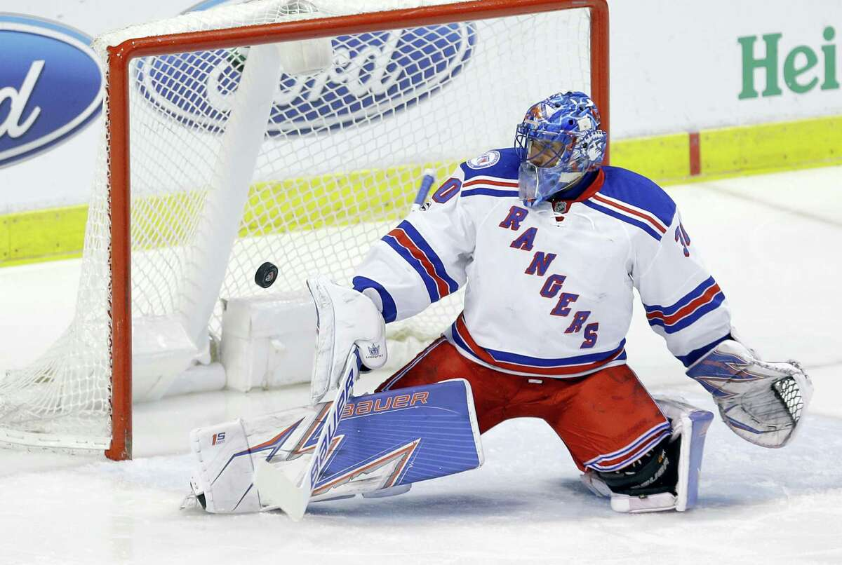 New York Rangers goalie Henrik Lundqvist deflects a shot by the Florida Panthers in the first period. The Rangers beat the Panthers 5-2.