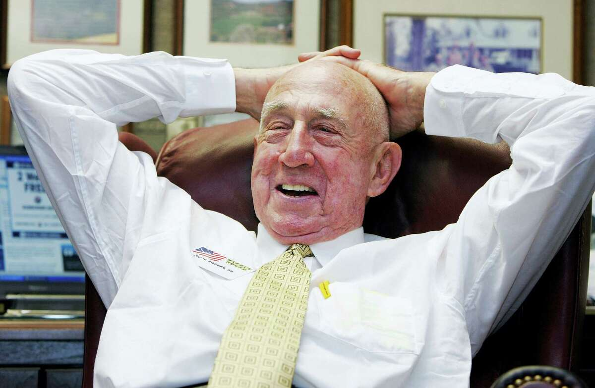 In this July 26, 2005 photo, Waffle House co-founder Joseph Wilson Rogers Sr., sits in his office in the Waffle House headquarters in Norcross, Ga. Georgia-based Waffle House said Rogers died March 3, 2017. He was 97.